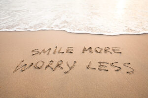 Smile more worry less positive thinking concept, optimism